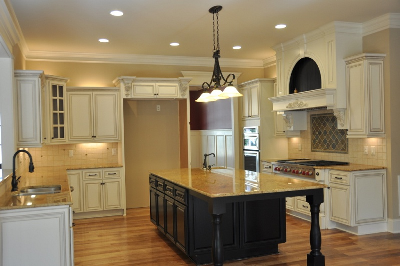 country-linen-cabinets-with-dark-island